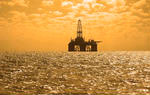 Stock photo oil rig at sunset