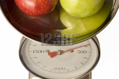 Apples in Scales at 123rf