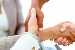 Crossed Handshakes stock photo