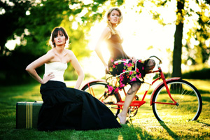 Girls and Red Bike Stock Photo - Vetta Collection